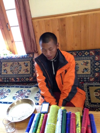 Pemba Tenzing blesses prayer flags in Namche Bazaar